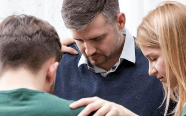 Family-Praying-Hugging