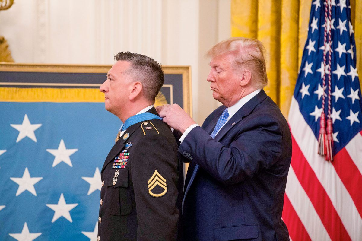 President Donald J. Trump presents the Medal of Honor to former Army Staff Sgt. David G. Bellavia during a ceremony at the White House in Washington, D.C., June 25, 2019.